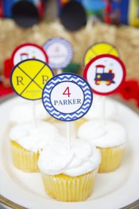 train cupcake toppers at a train birthday