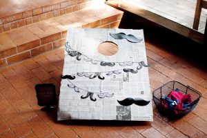 mustache bean bag toss at a little hipster man party