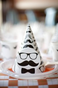 mustache party hats at a little hipster man theme