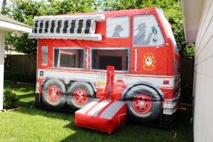 firetruck bounce house at a fireman birthday party