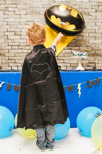 batman birthday party and boy with batman cape