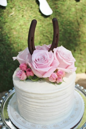 Kentucky Derby birthday party cake with a horseshoe topper