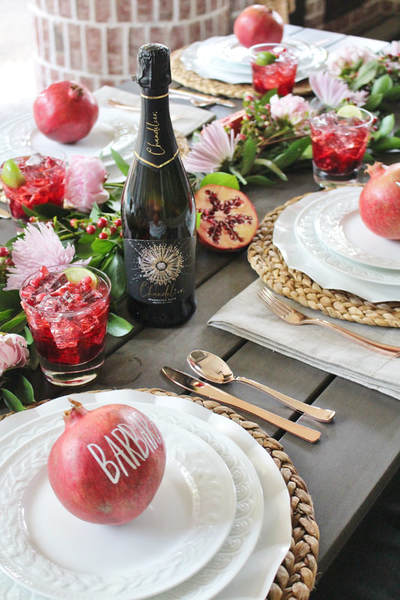 pomegranate inspired tablescape with pomegranate placecards