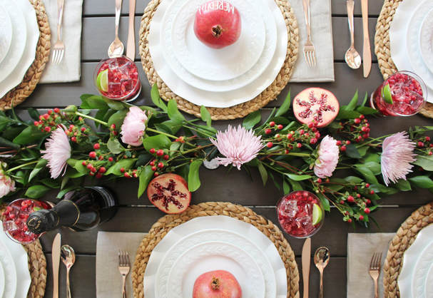 pomegranate inspired tablescape design with fresh floral runner