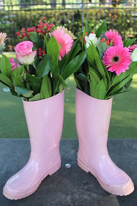 flowers in rubber boots at a peppa pic party