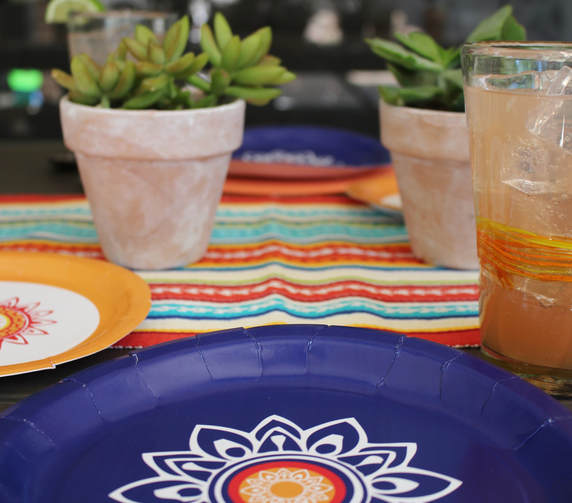 Fiesta tablescape with floral paper plates