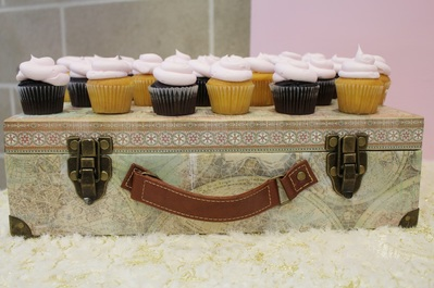 cupcakes displayed on a suitcase