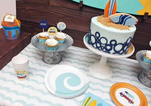surfboard birthday party with surfboard cake
