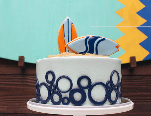 surfboard cake for a surf theme birthday party
