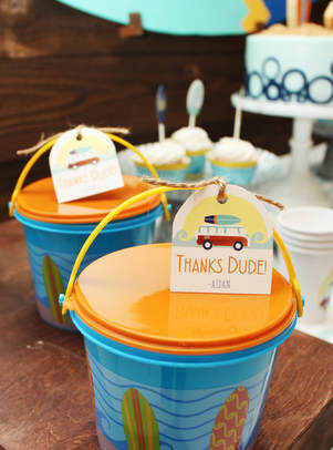 surf party favor buckets with surfer favor tags
