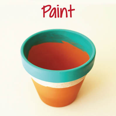 painting the rim of a terra cotta planter