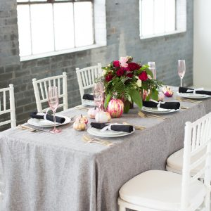 fall tablescape with gold leaf pumpkin centerpiece