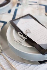 laser cut wooden place cards at a modern wedding