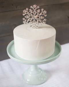 snowflake cake topper at a winter baby shower
